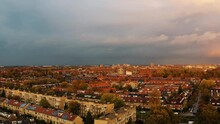 Aerial View Of Utrecht City With Beautiful Sunset And Dramatic Clouds Over Red Rooftops
