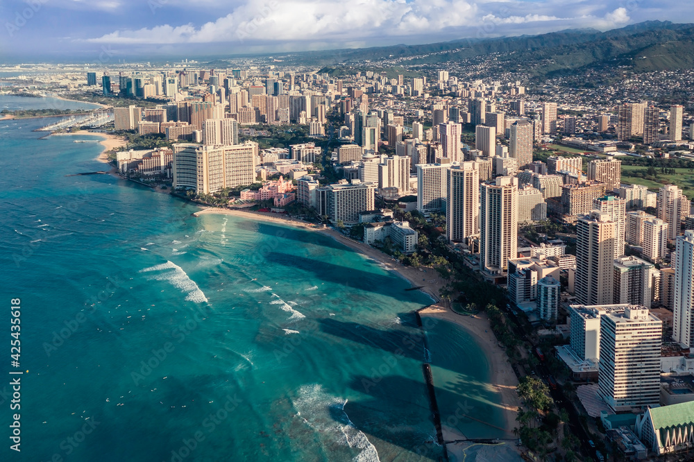 Fototapeta Sunrise above Waikiki Beach in Honolulu, Oahu Island, Hawaii. Famous surfers place on the island