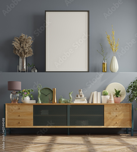 Mock up poster in modern living room interior design with dark blue empty wall.