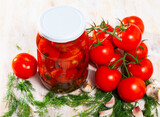 Fresh tomatoes canned in glass jar, homemade pickles