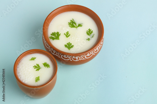 Obraz Summer cooler Buttermilk drink. Made of yogurt. Buttermilk made with yogurt. - fototapety do salonu