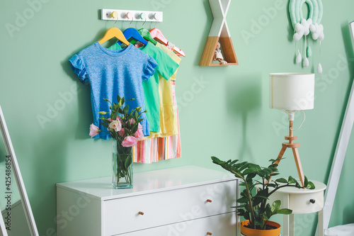 Obraz Rack with clothes in interior of children's room - fototapety do salonu