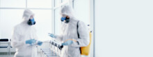Background Image A Team Of Professional Disinfector Works In A Public Building .