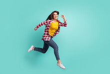 Full Length Body Size View Of Attractive Active Glad Cheerful Girl Jumping Running Motion Isolated Over Bright Teal Turquoise Color Background