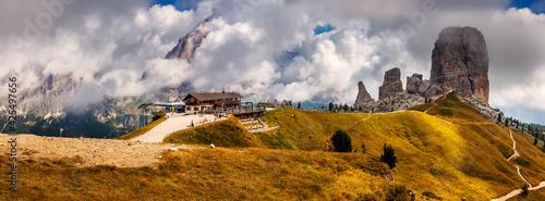 Fototapeta Wonderful mountain panorama Dolomites alps. Amazing nature landscape. View on Cinque Torri, Rifugio Scoiattoli and Tofana Rozes in clouds. Popular travel and hiking destination. Amazing Nature Scenery obraz
