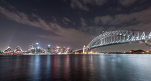 Sydney Harbour Bridge And Opera House. Long Exposure. Flowing Sky