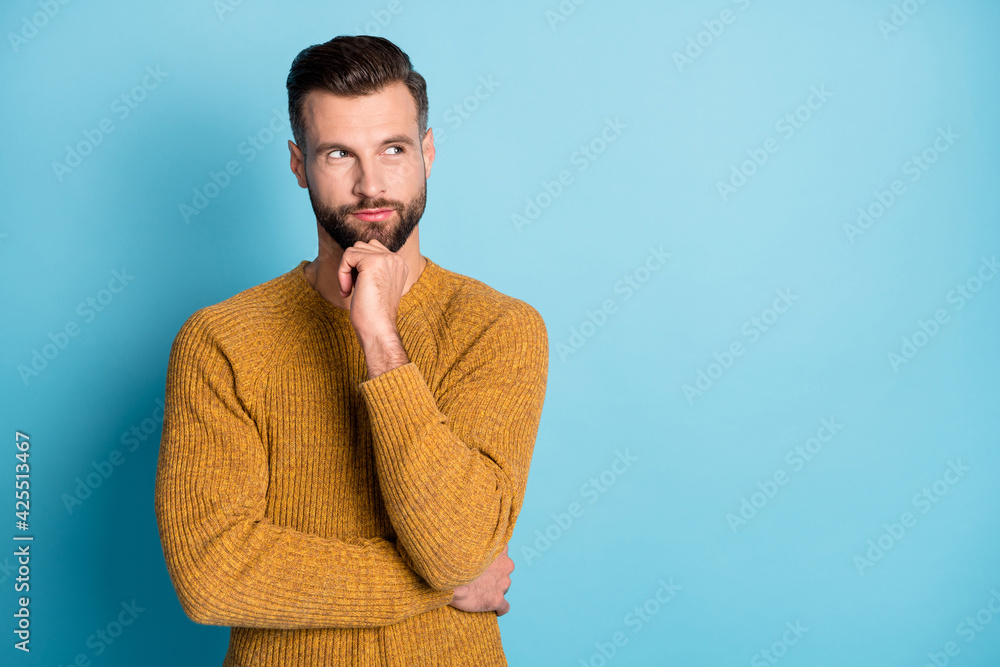 Fototapeta Photo of young attractive handsome thoughtful man thinking look copyspace hold hand chin isolated on blue color background