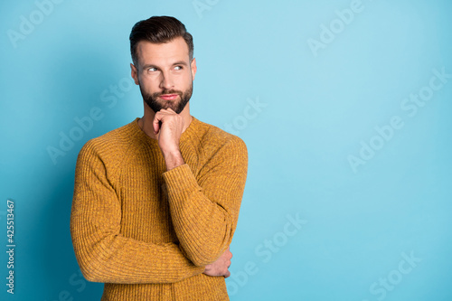 Photo of young attractive handsome thoughtful man thinking look copyspace hold hand chin isolated on blue color background