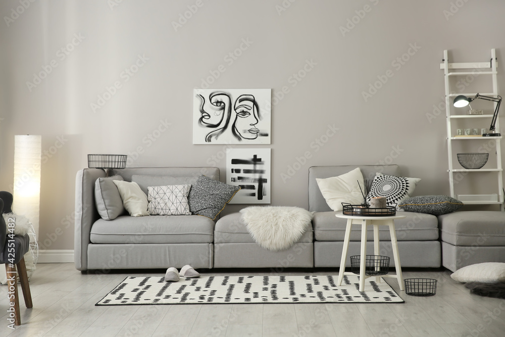 Fototapeta Cozy living room interior with big grey sofa
