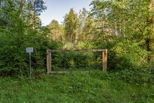 Closed Gate With A Sign: Deponie Betreten Verboten (German For: Landfill, Do Not Enter), Seen In A Forest In Ratingen, North Rhine-Westphalia, Germany