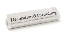 Rolled Newspaper With The Headline Decorating And Furnishing