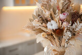 Bouquet of dry flowers and leaves in kitchen. Space for text