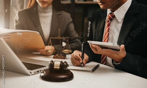 Businessman and Male lawyer or judge consult having team meeting with client, Law and Legal services concept in office.