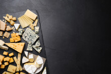 Cheese Plate On Black Table, Top View. Space For Text