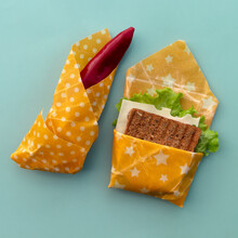 Reusable Food Beeswax Wrappers In Different Sizes. Organic Fabric Covers For Storing Food. Zero Waste Concept. Take Away Lunch.