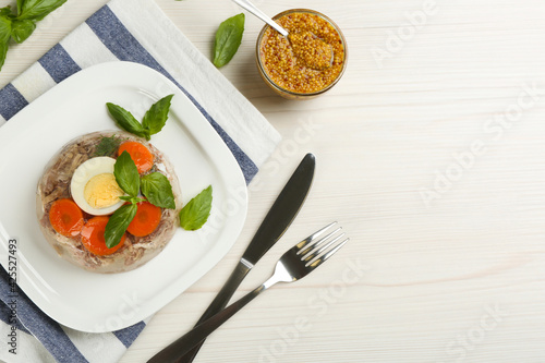 Obraz Delicious aspic with meat served on white wooden table, flat lay. Space for text - fototapety do salonu