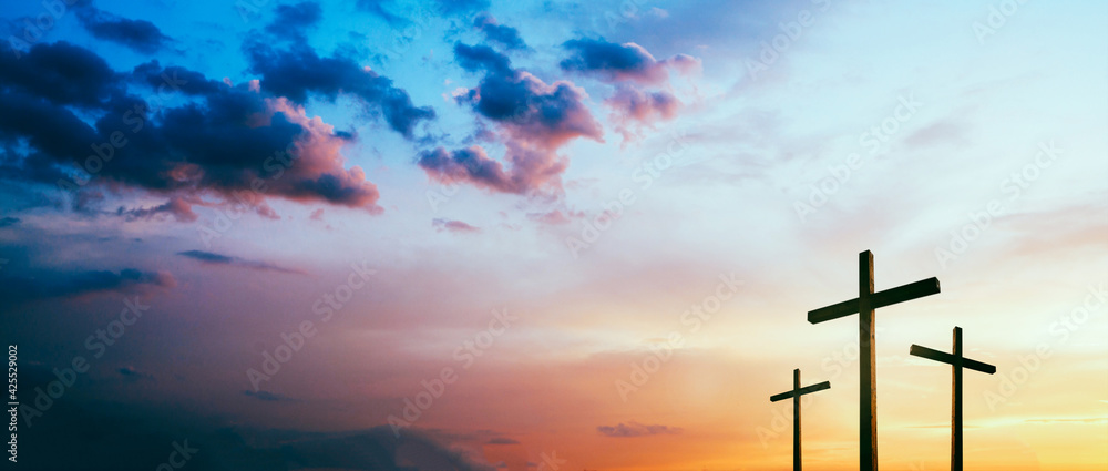 Fototapeta Easter concept. Cross of Jesus Christ empty over dramatic sunrise sky panorama with sclouds.