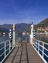 Pier On The Lake, Starting Point For Tourist Boats To Visit The Amazing Villages Of Lake Como.Lombardy,italian Lakes,Italy.