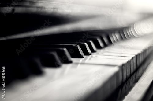 Piano keys closeup monochrome. Side view Fotobehang