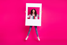 Full Size Photo Of Young Funky Funny Smiling Excited Girl Jumping With Big White Frame Isolated On Pink Color Background