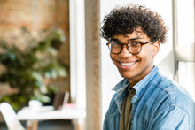 Close-up Portrait Of A Mixed-race Young Man In The Modern Office
