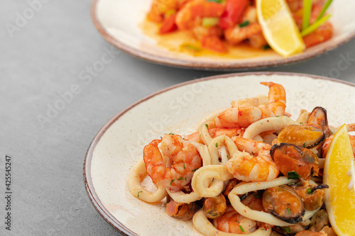 Stir fried seafood with sauce on plate with napkin
