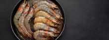 Raw Pacific White Prawns On Dark Background. Fresh Seafood Concept.