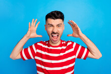 Photo Of Mad Furious Young Unhappy Man Raise Hands Scream Conflict Isolated On Pastel Blue Color Background