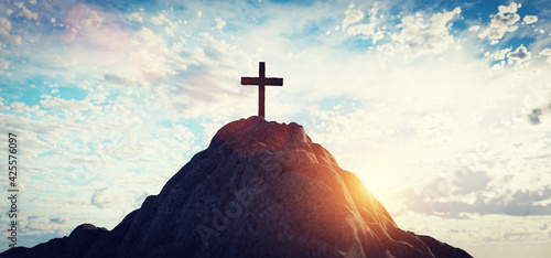 Cross on mountain peak at sunset christian religion Fototapet