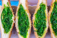 Seaweed Salad Sandwich For Sell At Street Food Market In Thailand . Tasty Green Seaweed Salad Sandwich Close Up