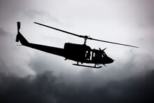 Untitled Helicopter Flying In The Sky Photo. Helicopter With No Markings. Silhouette Shot.