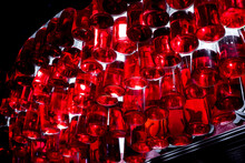 Decorative Lighting Of A Liquor Store Selling Alcoholic Beverages From Hanging Bottles With Red Liquid Hanging Like A Chandelier Upstairs Bottom View Close-up.