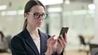 Portrait of Young Businesswoman using Smartphone