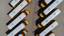 Looking Down Over A Row Of School Bus