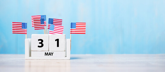 31 May of white Calendar with United States of America flag on wood background. Memorial day 2021 and Holiday concept
