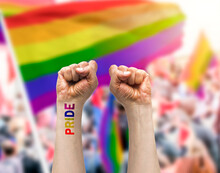 Gay Guy's Hand With A Tattoo That Says Pride With White Background. Symbol Of Sexual Liberation And Tolerance