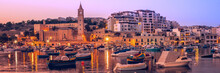Fisherman And Passenger Boats In Marsaskala Bay In Malta