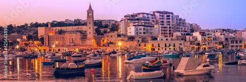 Fisherman and passenger boats in Marsaskala bay in Malta Fototapet