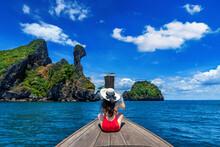Beautiful Girl In Red Bikini On Boat At Koh Kai Island, Thailand.