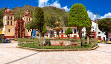 Cathedral Of The City Of Huancavelica And Old Fountain From The Colonial Era On A Sunny Day