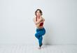 woman in blue leggings gymnastics sport fitness yoga asana