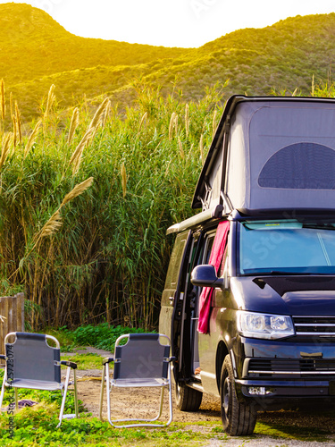 Fotografija Camper van with roof top tent camp on nature