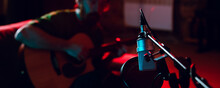 Close-up Of Musician Performing In Neon Light. Concept Of Advertising, Hobby, Music, Festival, Entertainment.