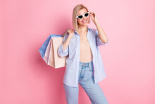 Photo Of Attractive Sweet Lovely Lady Hold Bags On Shoulders Wear Sunglass Isolated On Pink Color Background