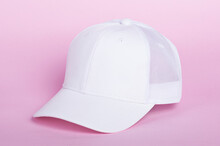 White Cap Mockup. Blank Trucker Hat Isolated On Pink Background