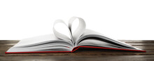 Open Book With Pages Folded In Heart On Wooden Table Against White Background