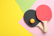 Ping Pong Rackets And Ball On Color Background, Flat Lay. Space For Text