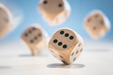 Fototapeta Big Ben - Throwing and rolling wooden dice on a blue background