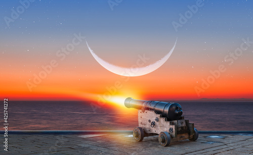 Leinwand Poster Ramadan Concept - Ramadan kareem cannon with crescent - Night sky with moon in t