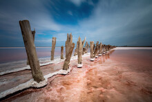 Moody Landscape Of Salt Lake, Natural Pink Color Of Salty Water. Long Exposure